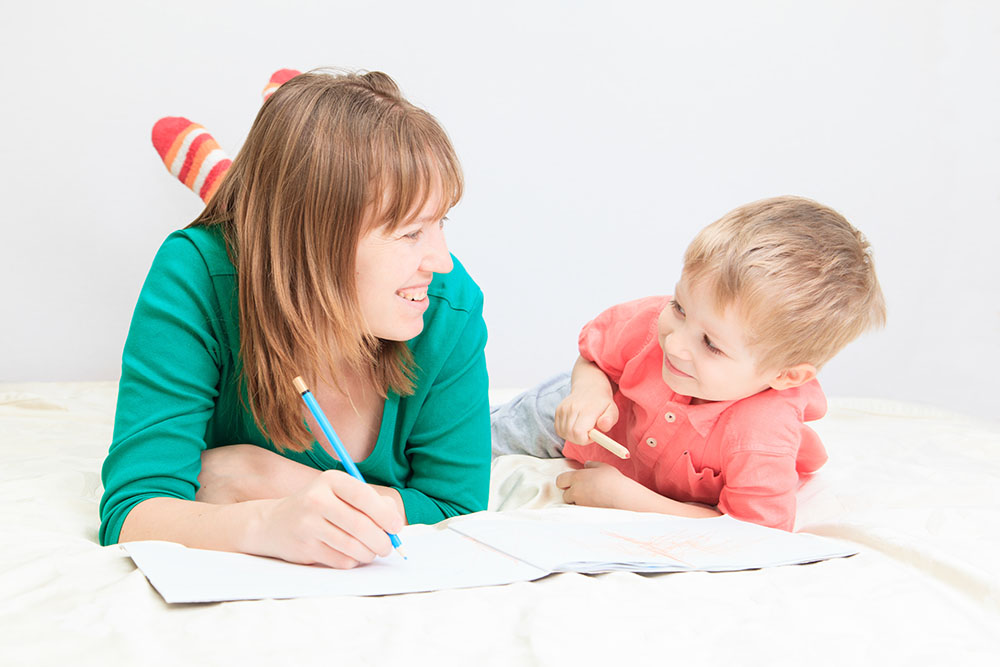 mother and son drawing together, early education concept at a Preschool & Daycare Serving Frisco, TX