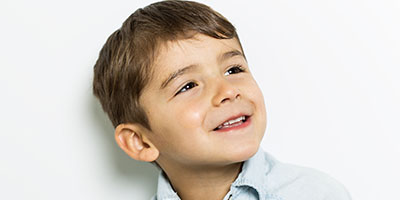 Cute little kid boy smiling at a Preschool & Daycare Serving Frisco, TX