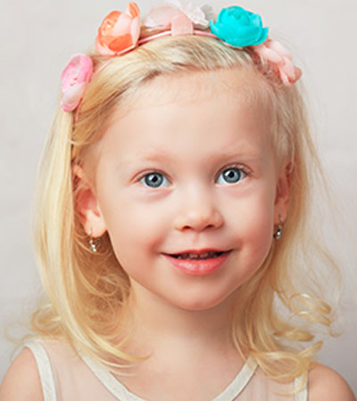 Cute little blond young girl at a Preschool & Daycare Serving Frisco, TX
