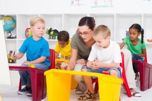 preschool students and female teacher in kindergarten at a Preschool & Daycare Serving Frisco, TX